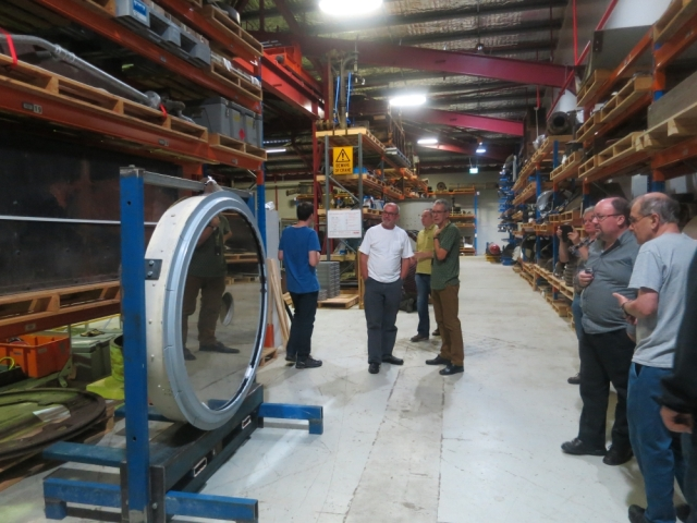 APS members inspecting the mirror from the GMT